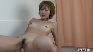 Slutty Asian lass getting her pussy plowed with two huge cocks